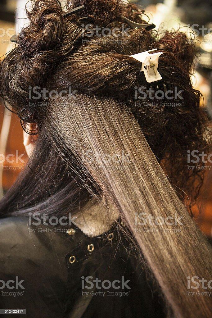 Hair Straightening at Salon stock photo