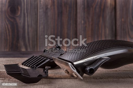 626488516istockphoto hair trimmer on an old wooden background closeup 638056036