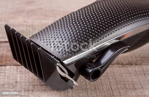 626488516istockphoto hair trimmer on an old wooden background closeup 638058084