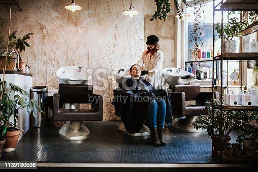 istock Hair washing and rinsing in fancy hair salon 1139130538