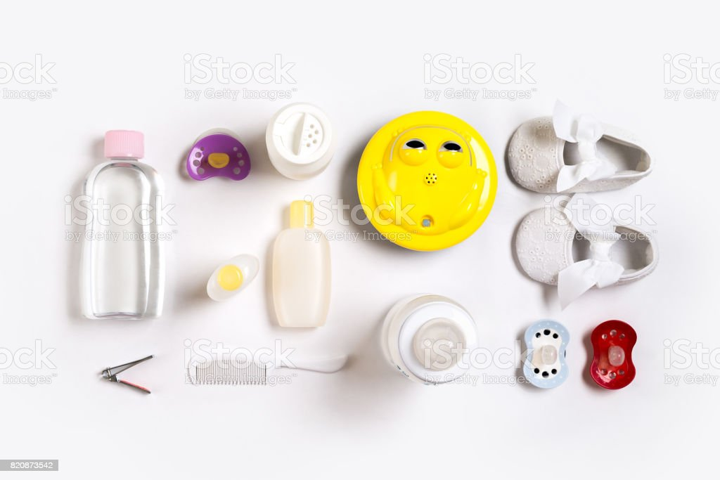 Hairbrush and cosmetics for newborns on a white background. Top view stock photo