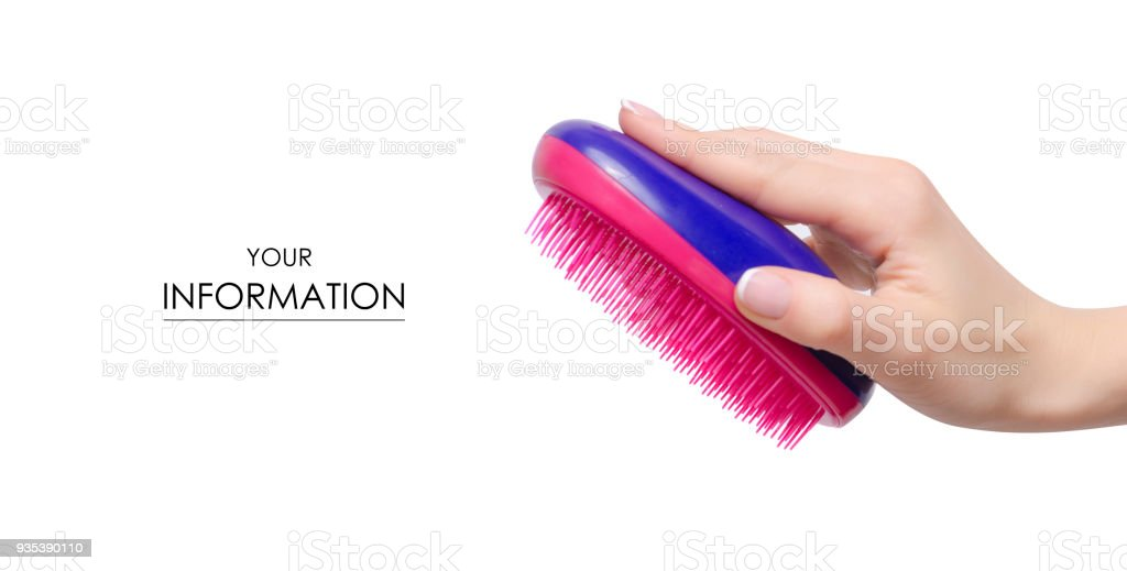 Hairbrush comb in hand pattern stock photo