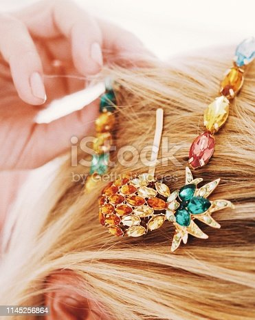 Hairclips accessories with gemstones. Modern hair fashion. Close up with hair.