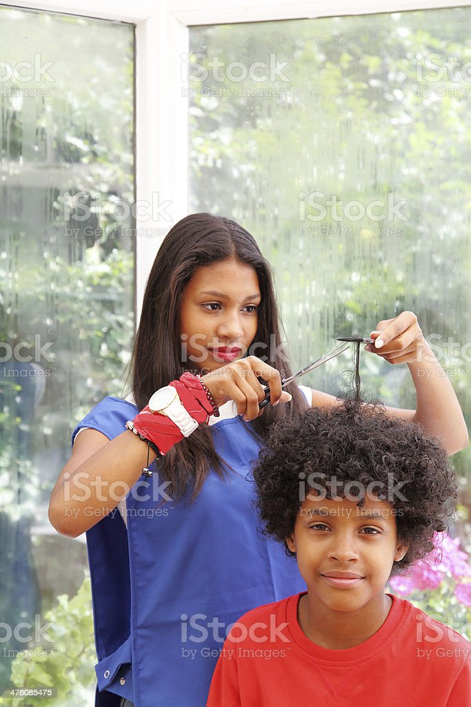 hairdresser and young boy stock photo