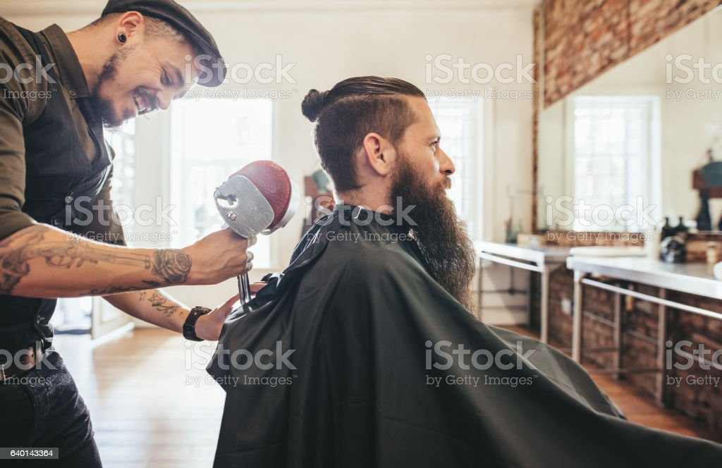Hairdresser attending the client stock photo