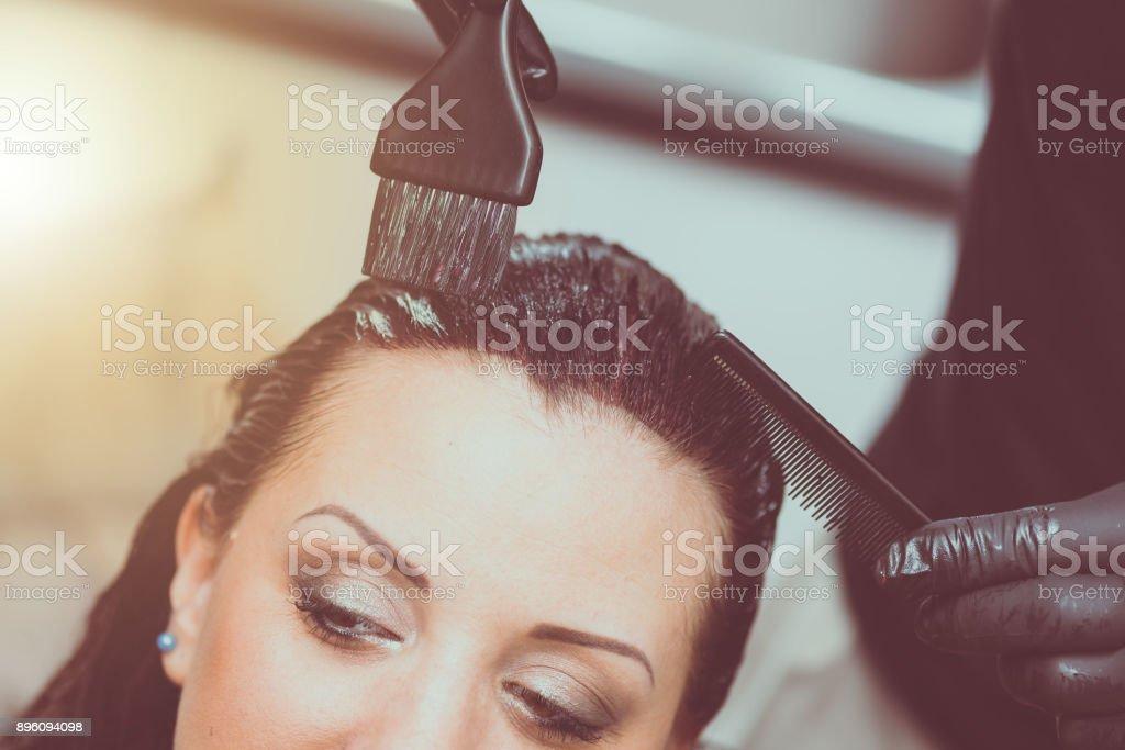 Hairdresser coloring hair, light effect stock photo