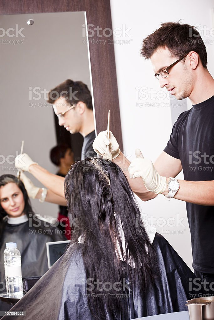 Hairdresser coloring hair royalty-free stock photo