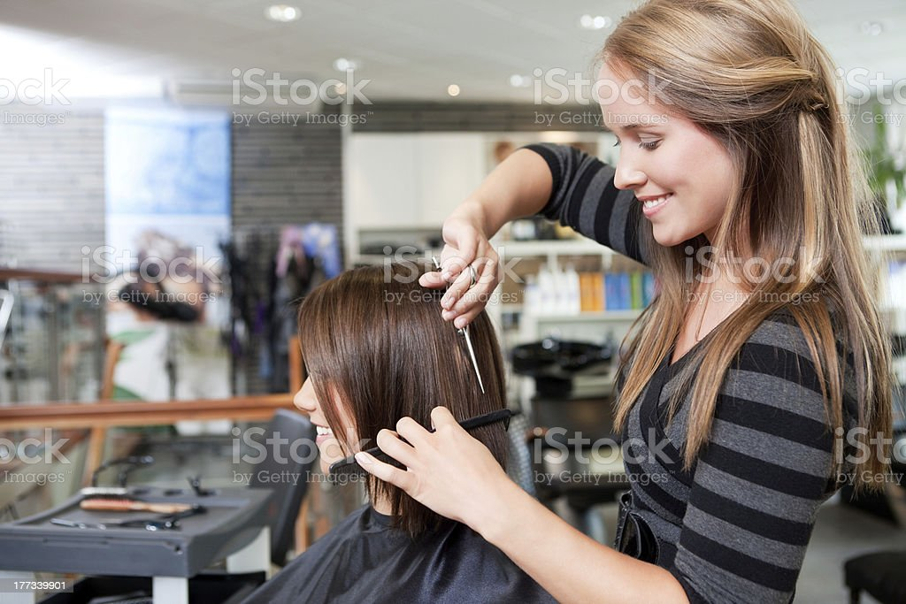 Hairdresser Cutting Client's Hair royalty-free stock photo