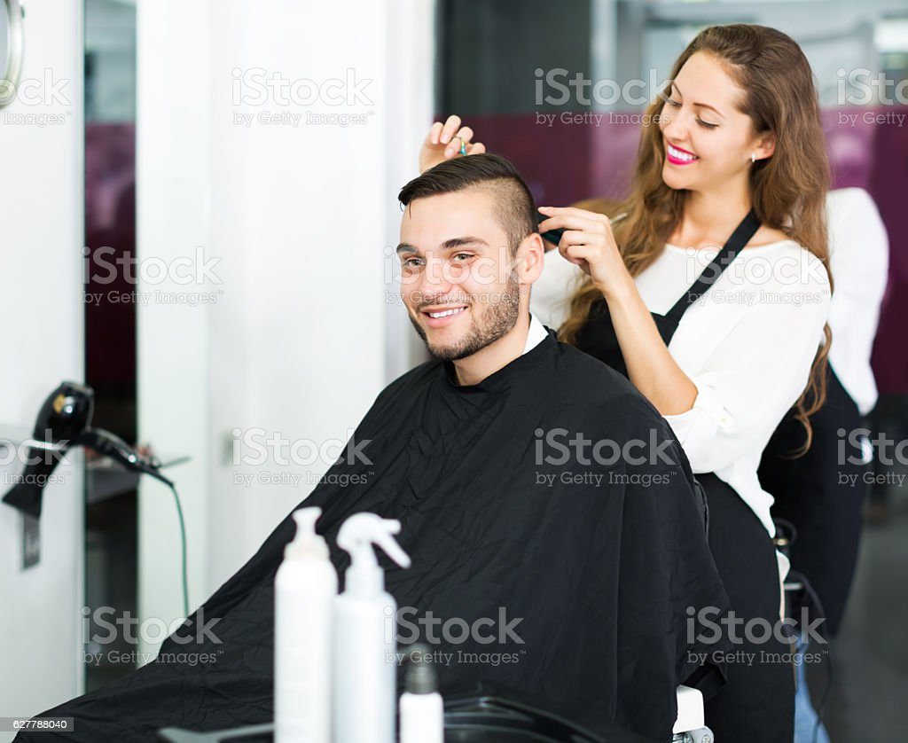 Hairdresser doing hairstyle stock photo
