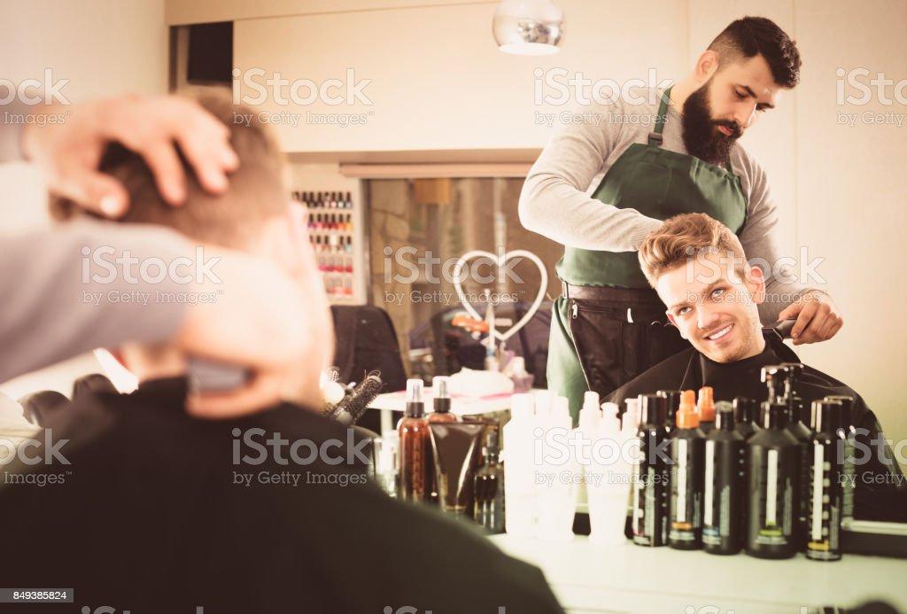 Hairdresser doing new haircut stock photo