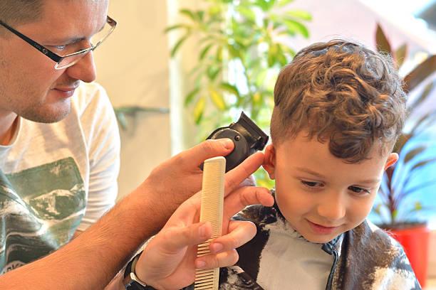 Hairdresser Getting Haircut in Hair Salon. stock photo
