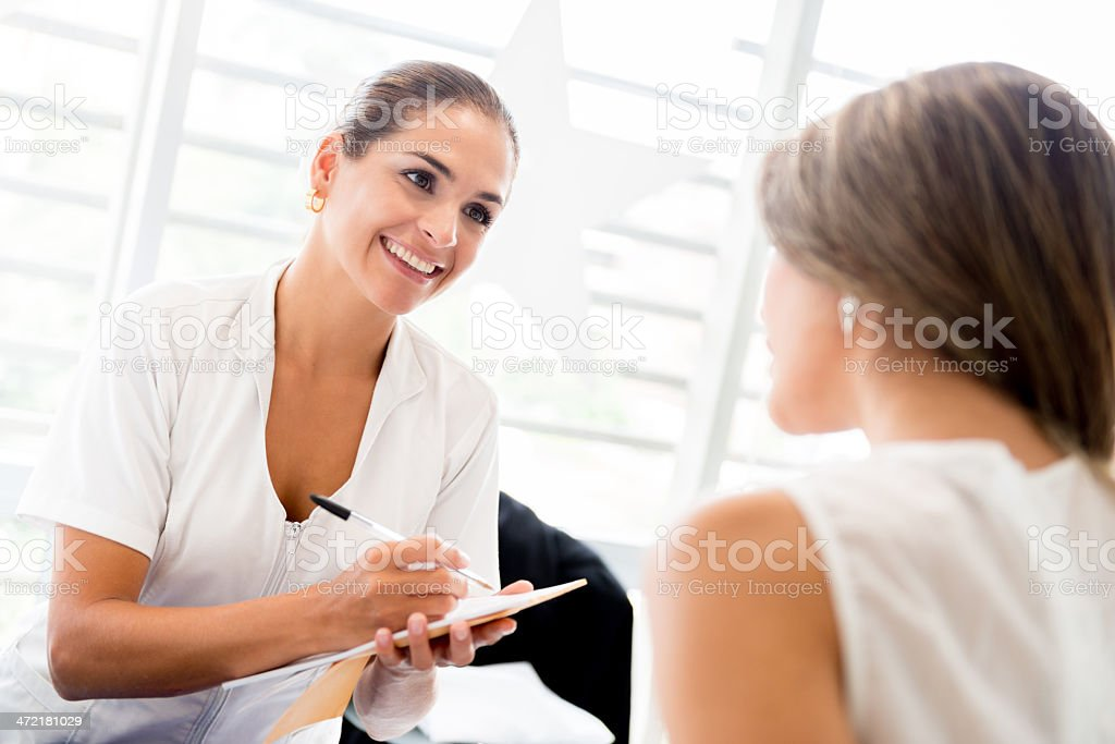 Hairdresser helping a client stock photo