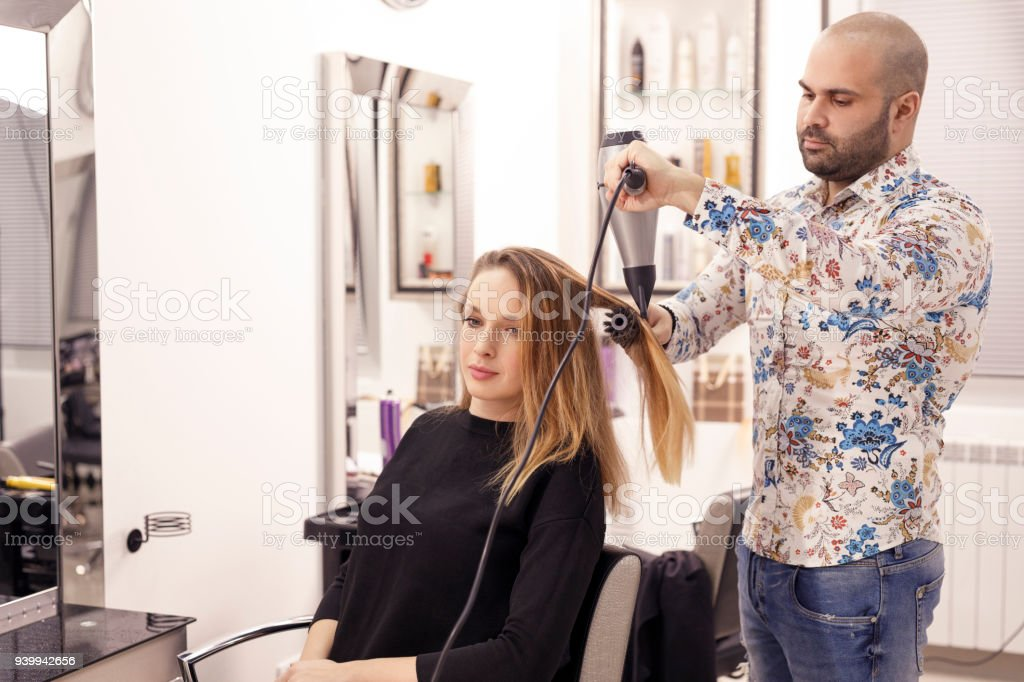 Hairdresser In Action Hair Styling Blowing Drying Long Hair Hair ... 66e8ff7cc8