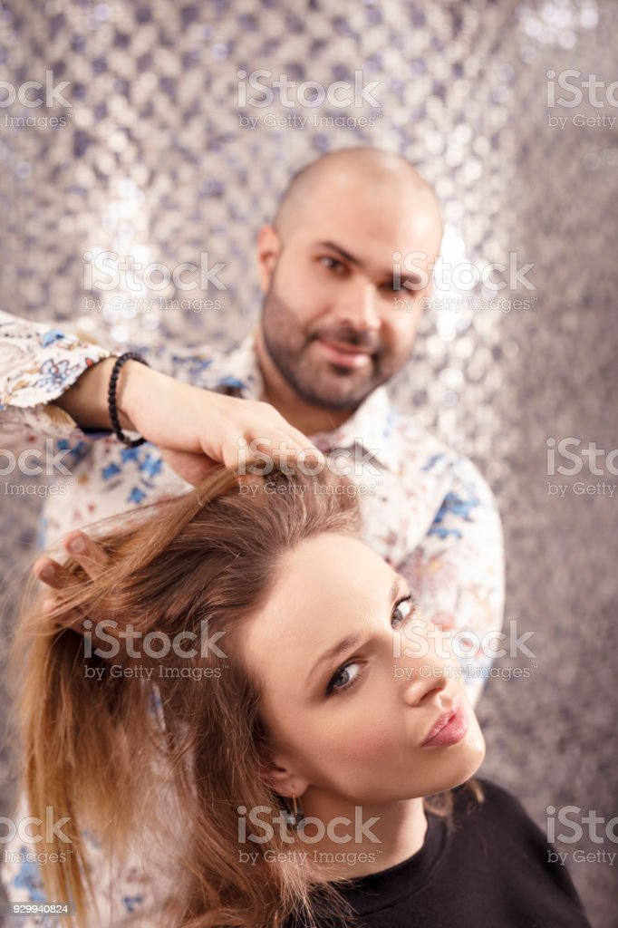Hairdresser in action. Natural Beauty woman at a hair salon - Stock image . f98c2370d1
