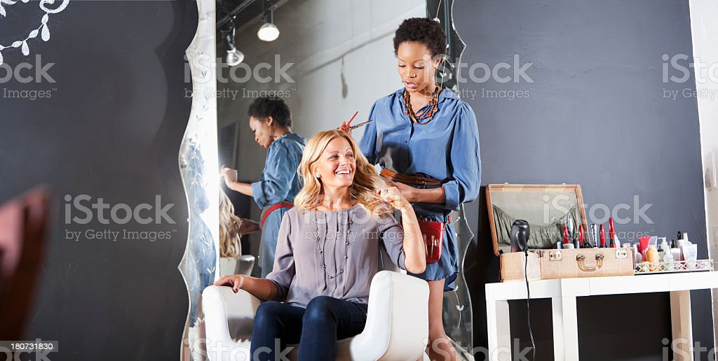 Hairdresser in salon with customer stock photo