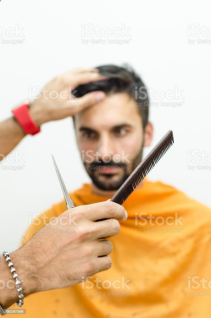 Hairdresser preparing for work and selects the appropriate tool royaltyfri bildbanksbilder