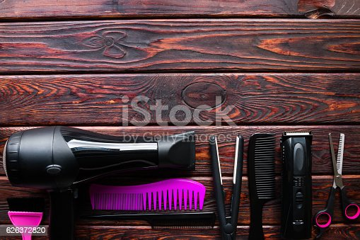 istock hairdresser set on a wooden background with space for text 626372820
