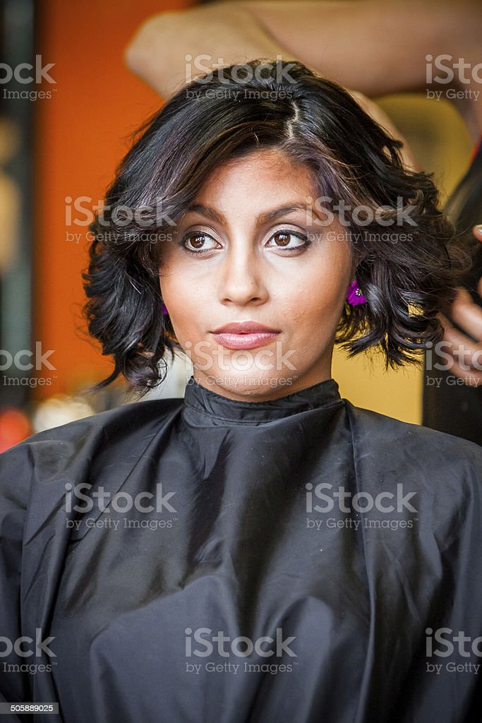 Hairdresser Styles Hair of Beautiful Woman stock photo