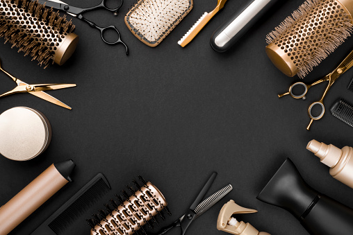 istock Hairdresser tools on black background with copy space in center 1020439322