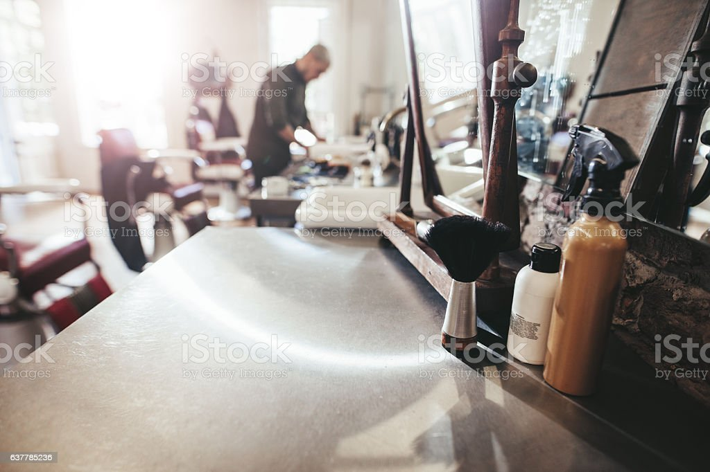 Hairdresser tools on counter at barber shop stock photo