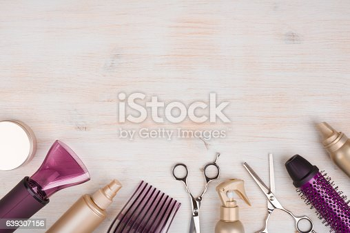 istock Hairdresser tools on wooden background with copy space at top 639307156