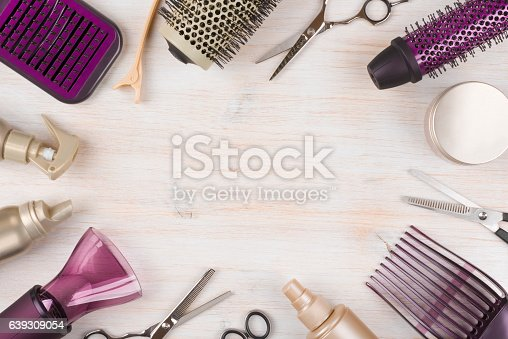 istock Hairdresser tools on wooden background with copy space in center 639309054