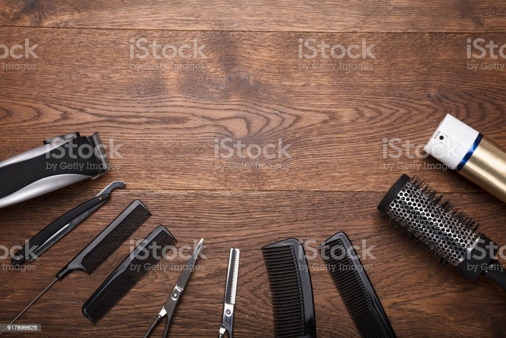 Hairdresser Tools On Wooden Desk stock photo