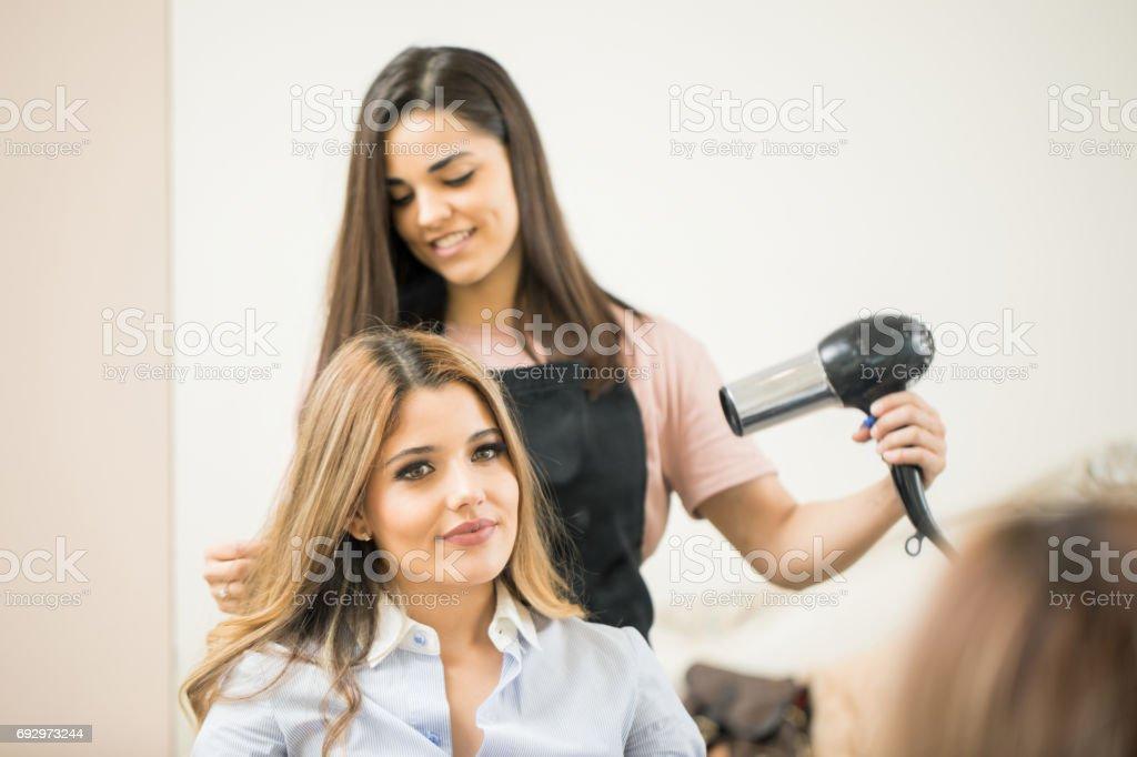 Hairdresser using a blowdryer stock photo