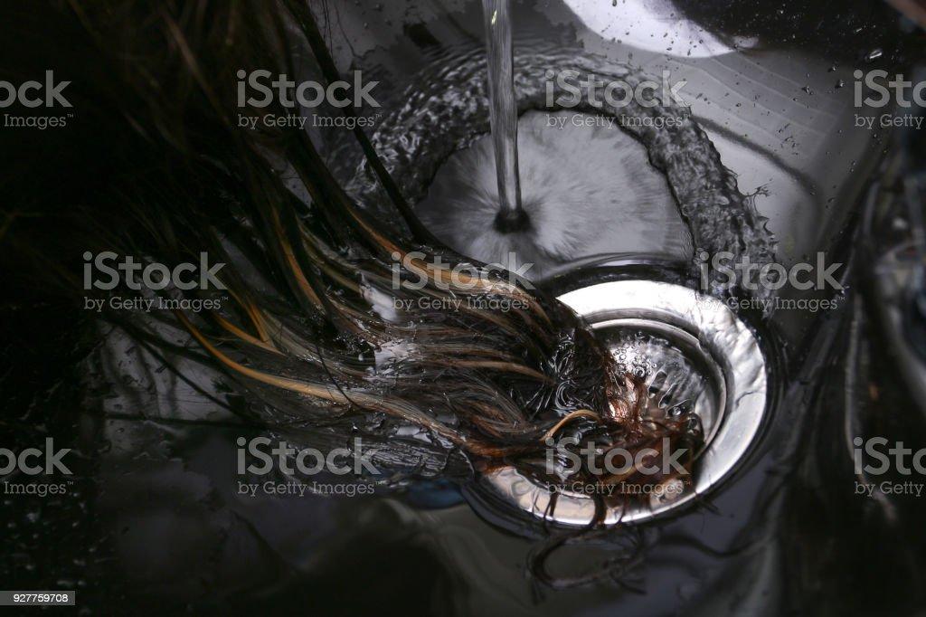 Hairdresser washing woman's hair in hairdresser salon stock photo
