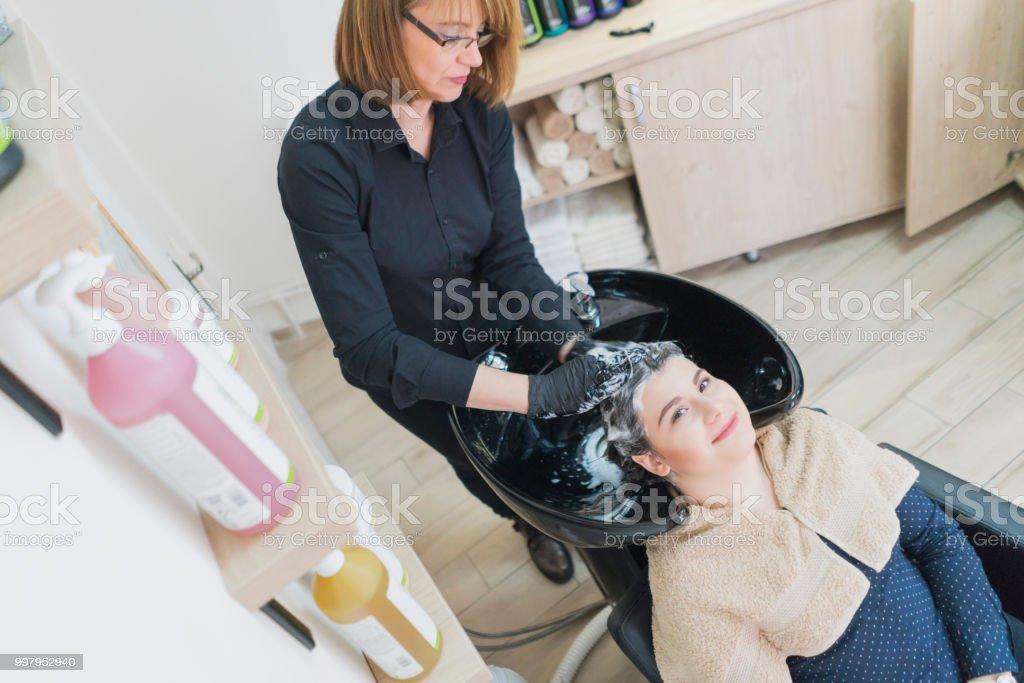 Smiling and enjoying in washing hair