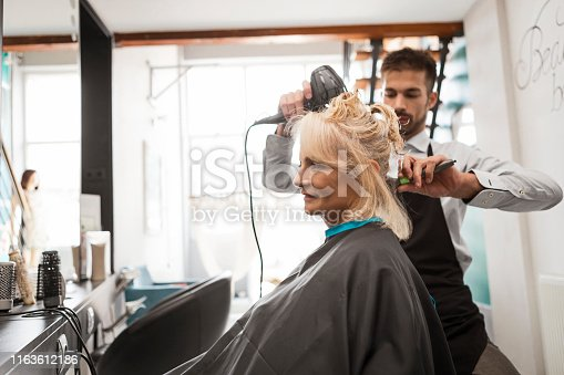 Mature woman getting her hair cut