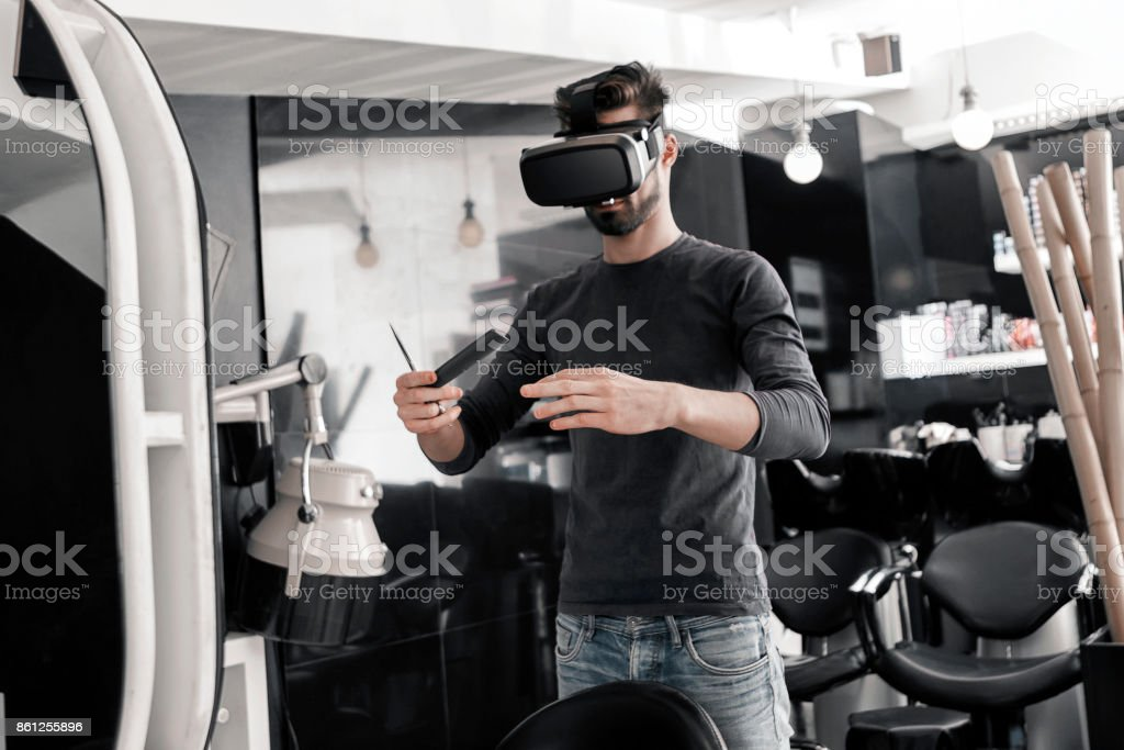 Hairdresser with virtual trainer stock photo
