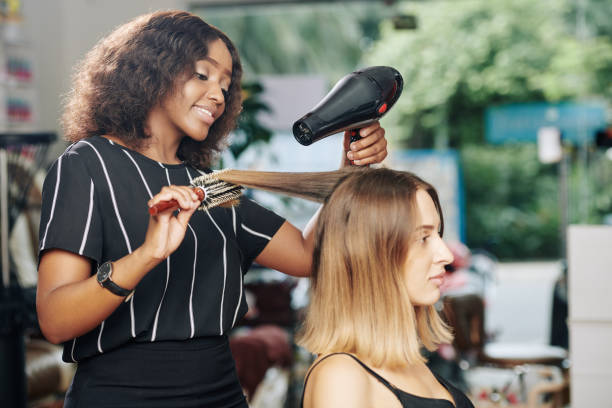 Hairdresser working in beauty salon stock photo