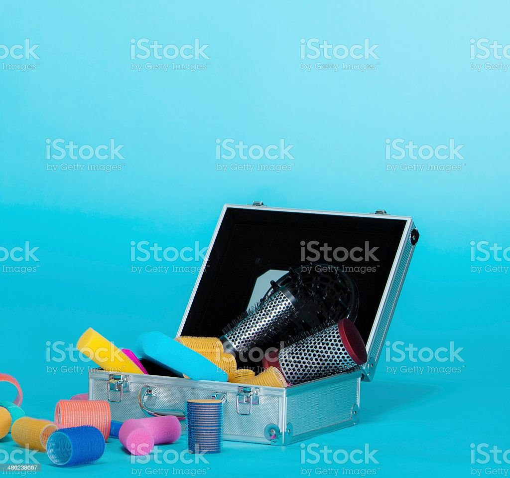 Hairdressing. Hair accessories curlers in suitcase. Copy space for text royalty-free stock photo
