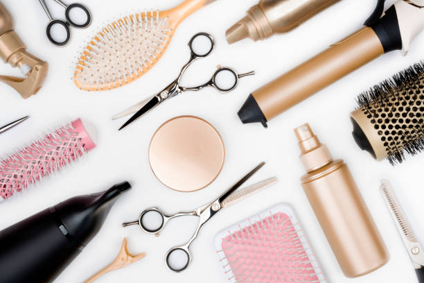 Hairdressing tools and various hairbrushes on white background top view stock photo