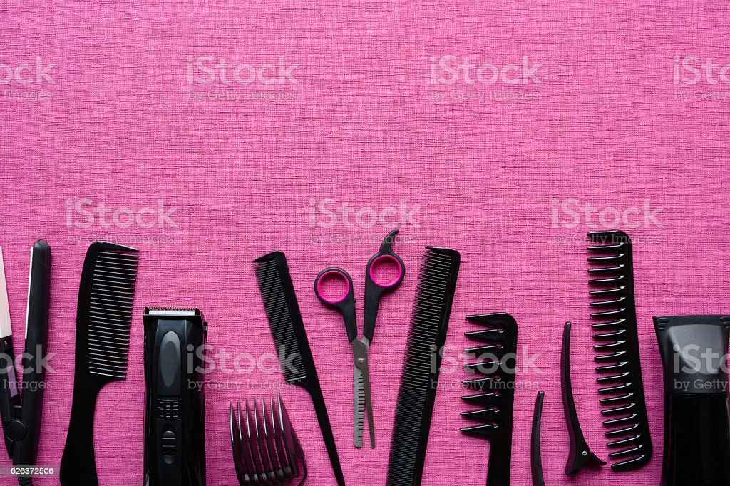 hairdressing tools on pink background and space for text stock photo