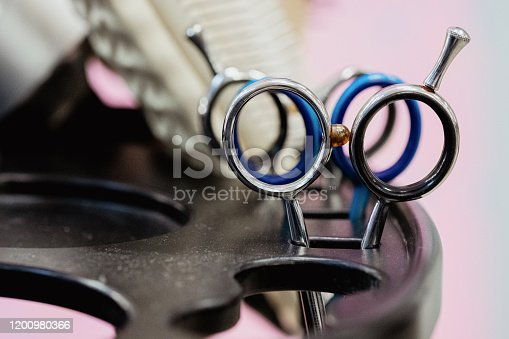 696318954 istock photo Hairdressing tools on white and pinksilver background. 1200980366