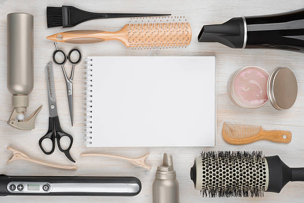 hairdressing tools on wooden background with blank sheet in centre - beautician stock photos and pictures