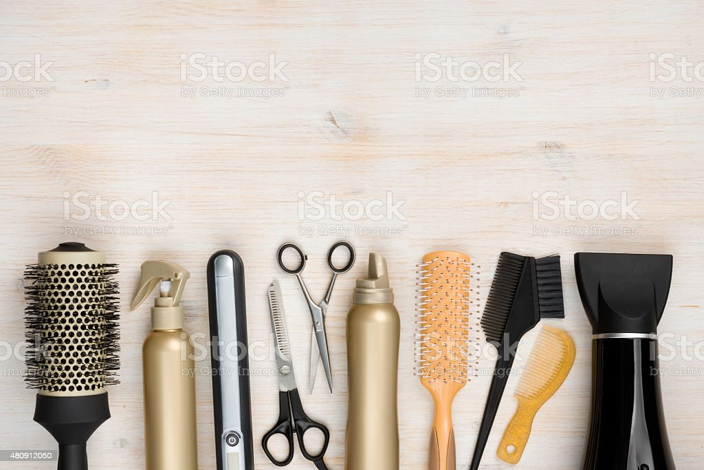 Hairdressing tools on wooden background with copy space at top royalty-free stock photo