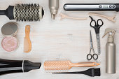 istock Hairdressing tools on wooden background with copyspace in the middle 501653896
