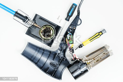 istock Hairdryer in a disassembled condition. 1041180976