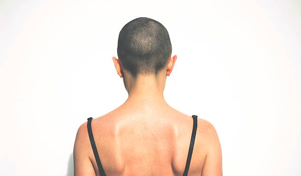 Hairless woman Hairless woman shaved head stock pictures, royalty-free photos & images