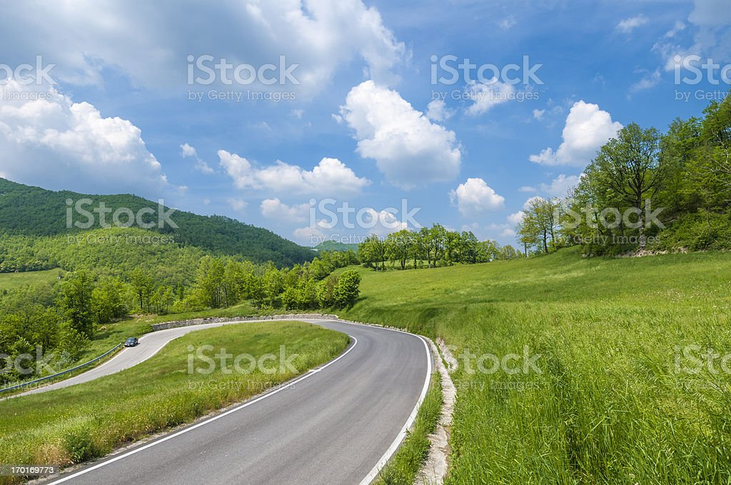 Hairpin bend in a winding country road royalty-free stock photo