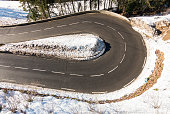 istock Hairpin bend on a winding road in the alps 1338077197