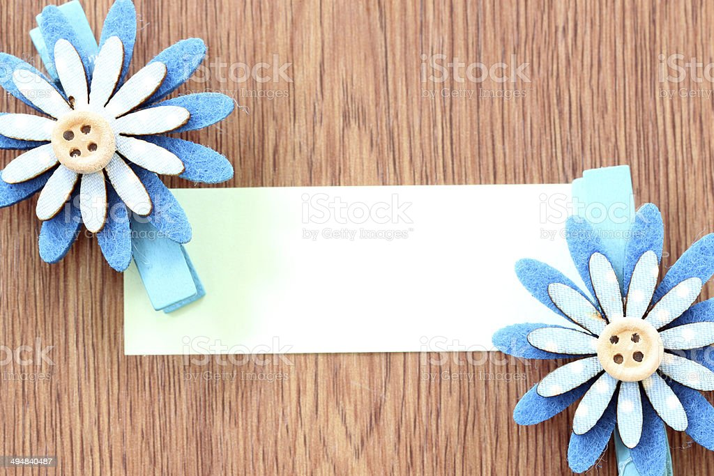 Hairpins of blue flower pattern and note paper. royalty-free stock photo