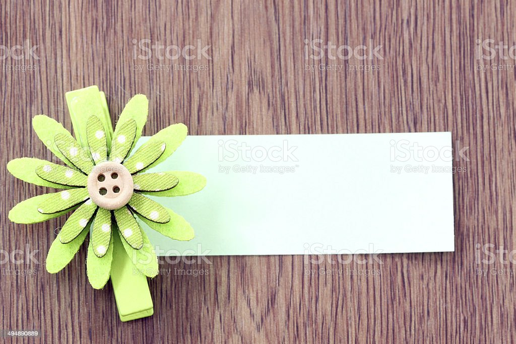 Hairpins of green flower pattern and note paper. royalty-free stock photo