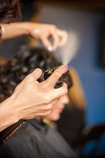 Hairspray Being Sprayed at a Salon stock photo
