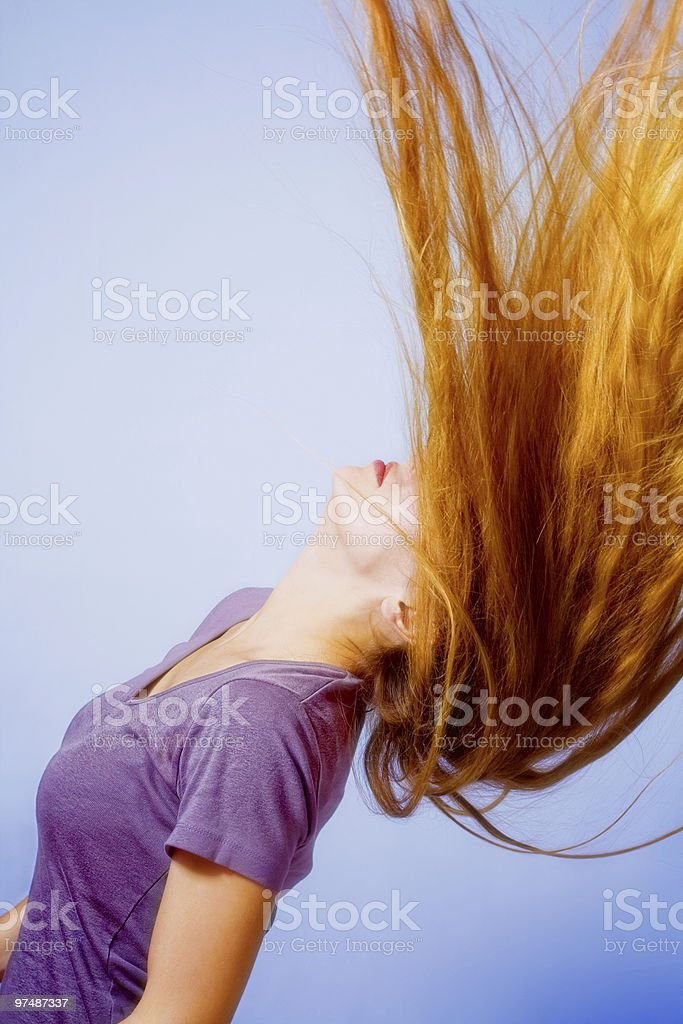 Hairstyle action - woman with long hair in motion royalty-free stock photo