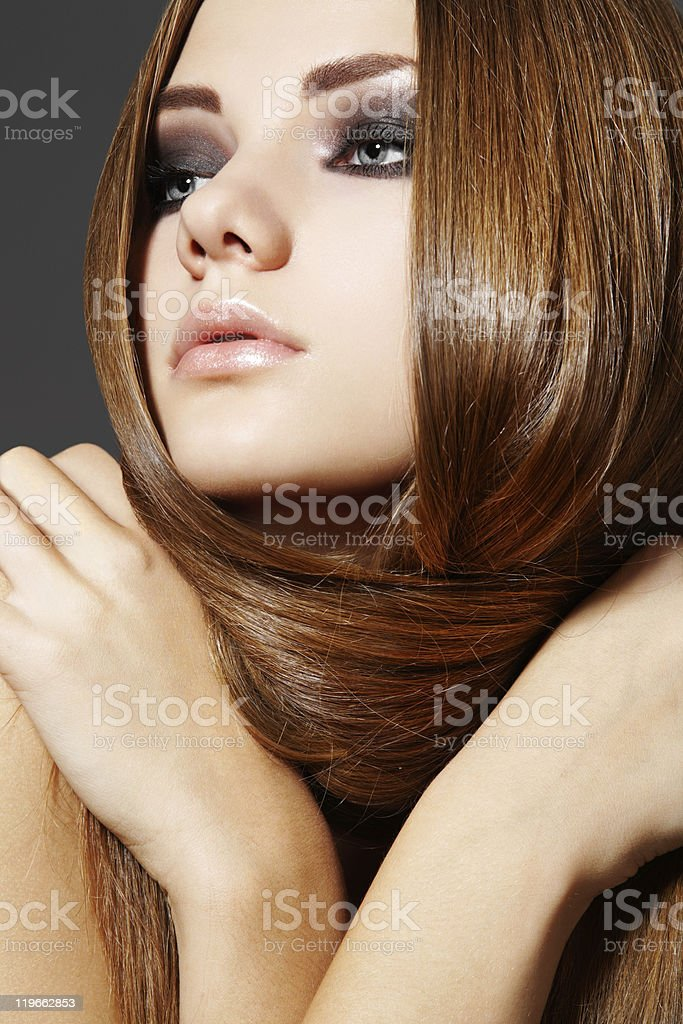 Hairstyle. Beautiful model with long shiny hair stock photo