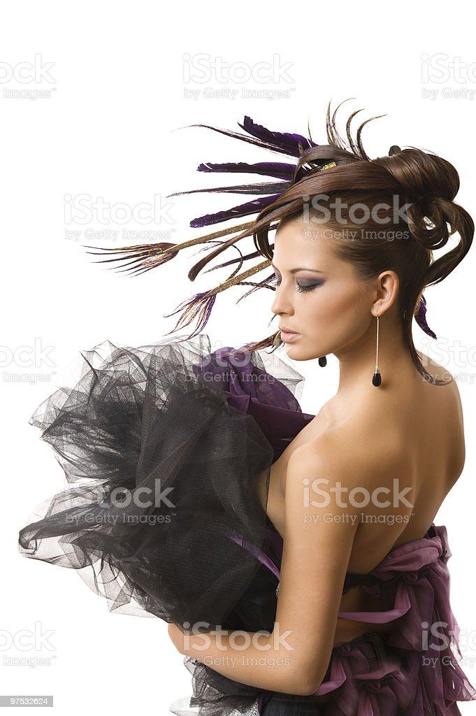 Hairstyle with feathers of peacock royalty-free stock photo